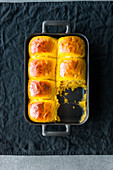 Soft pumpkin rolls baked in a baking tin