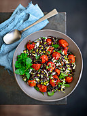 Black rice salad with roasted cherry tomatoes, pistachios and peppermint
