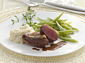 Pigeon breast on celery cream with beans