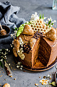 Gingerbread and honey cake decorated with gingerbread hearts and chocolate in the shape of honeycombs