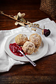 Potato dumplings with berry sauce