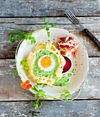 Potato mash with egg, green sauce and raw salad