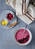 Smoothie bowl with fresh berries and sesame