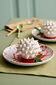 Citrus cream balls with whipped cream and meringue toppings