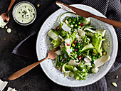 Pea salad with courgette and Parmesan cheese