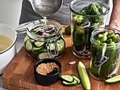 Cucumbers being pickled