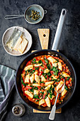 Gnocchi with tomato sauce with chili and capers
