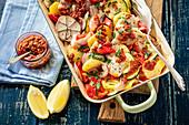 Fish and veggies bake with dried tomatoes pesto