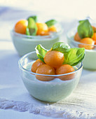 Melon cream with melon balls and basil