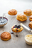 Scones with cream and blueberry jam