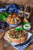 Mushroom pizza with sour cream