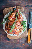 Chicken wrapped in bacon roast with rosemary