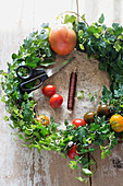 Handmade ivy wreath with multicoloured tomatoes