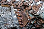 Crushed aluminium and radiators at a metal recycling centre