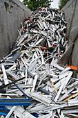 Skip full of aluminium at a metal recycling centre
