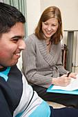Social worker visiting disabled teenager at home