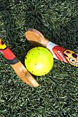 Pair of hockey sticks clashing over a ball