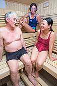 Adults relaxing in a sauna