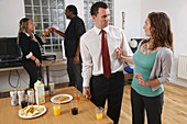 Woman rejecting unwanted advances from man at party