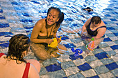 Women with learning disability in swimming pool