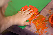 Person with learning disability hand painting