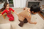 Children chasing round a room