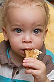 Toddler eating toast