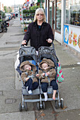 Childminder with twins in buggy