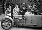 Denis Evans inspecting the plugs of his Bugatti Type 43