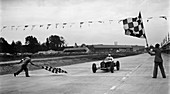 Alfa Romeo taking the chequered flag in a race at Brooklands