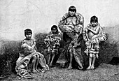 Alakaluf Fuegians, dressed in guanaco skins, Chile, 1895