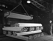 Steel H girders being stacked for distribution, 1964