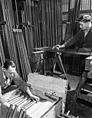 Packing drill and pneumatic bits at a steel foundry, 1962