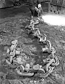 Cutting off lead from a manganese chain casting, 1965