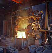 75 ton arc furnace pouring molten steel into a vessel, 1969