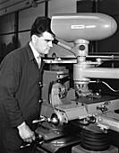 Worker using a cutting machine, 1964