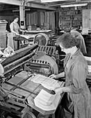 A folding machine in a printworks, 1959