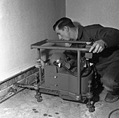 Installing a damp proof course in a house, 1957