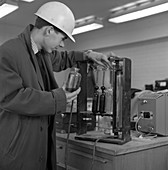 Lab testing at steel company, 1964