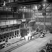 Teeming molten iron, 1964