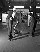 Rolling steel bars, Rotherham, South Yorkshire, 1964