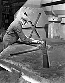 Grinding the flashing from a casting, 1963