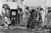 Diver and his apparatus on board HMS 'Blake, 1896