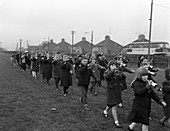 Children marching with home made bugles, 1964