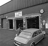 Mk 1 BMC Austin 1800 outside a tyre fitting bay, 1969