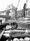 Lighters approaching wharf by Tower Bridge, London, c1905