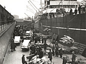 Cargo being loaded from a ship, London, c1930