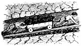 Boy 'putters' moving coal in a narrow seam, England, 1848