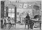 Charles Darwin, English naturalist, in his study, c1870