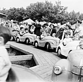Children on a fairground ride, Festival of Britain, 1951